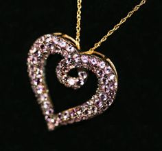 Curations NYC's African Amethyst Large Heart Pendant, set in Black Rhodium, and 14K Yellow Gold