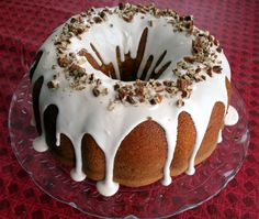 Butter & sour cream really make the simple cake super-moist–even the next day after storing it with a big hunk missing.  And the addition of rum is just perfection with the butter pecan f…