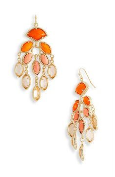 Loving these chic orange chandelier earrings by Kendra Scott @soir airaéebliss! Events