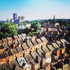 A lovely view over the city rooftops from the train. Durham Cathedral, Durham, England.