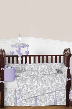 A gorgeous subtle color pallet of gray, lavender, and white will set your nursery up in high style. #Lavender and gray #damask #babybedding by Sweet JoJo Designs.