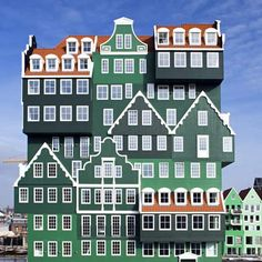 Delft studio WAM Architecten have completed a hotel that looks like a pile of houses in Zaandam, the Netherlands..  Providing 160 guest rooms, the hotel also offers a bar-restaurant, a swimming pool, and a wellness centre with a Finnish sauna and a Turkish bath.