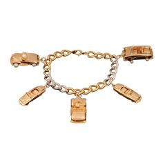 1950's Platinum and Gold Charm Bracelet