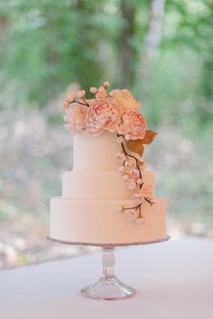 classic white wedding cake, antique cake stand, pink draping florals:  Bridal Bliss Wedding