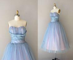 reminds me of a modern Alice In Wonderland dress.