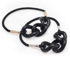 """These New Jet Black Ties are a great collection of """"the elastic all dressed up."""" Hair tie meets fashionable bracelet for the ultimate women's fashion accessory."""