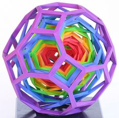 George W. Hart - For rainbow fans, here are six nested truncated cuboctahedra.  Again, the spiral way that each layer supports the next inner layer is worth a look.