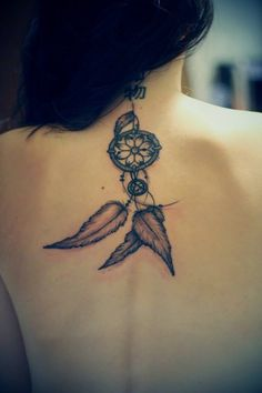 dreamcatcher back tattoo, maybe with a sun instead of a flower??