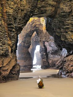 The Beach of the Cathedrals located in Ribadeo, Spain Over the years the water continuously pounds against these rocks, creating what looks like stunning cathedral architecture, all produced by the creative hand of nature.