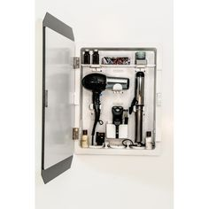 Organize hair care supplies, cosmetics, and toiletries in your master bath or powder room with this essential wall-mount cabinet, showcasing a mirrored front...