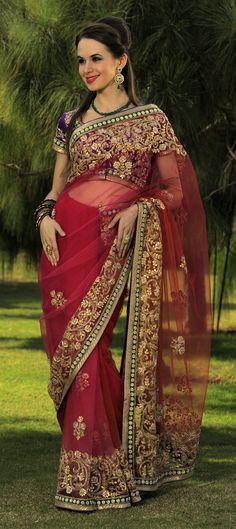 Exclusive theme based saree.Net is used,multicoloured Fusia to Red Net Saree. With Gota Jaal on Border & Mata Patti & Buti Allover.Available at- http://www.indianweddingsaree.com/product/69429.html