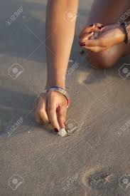Image result for photography picking shells hand