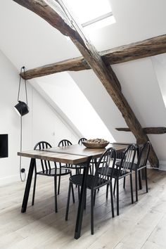 simplicity. black dining chairs, wooden beams, white walls//