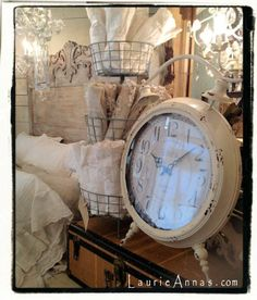Antique bed, oversized clock, vintage charm at LaurieAnna's Vintage Home in Canton, Texas.