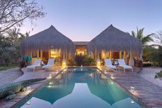 Striking symmetry at the Azura Island Benguerra Lodge in Southern Mozambique. Boutique Retreats, Island Holidays, Beautiful Hotels, African Safari, Cool Pools, Vacation Destinations, Trip Advisor, National Parks, Villa