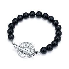 Toggle bracelet of black onyx beads with sterling silver. My husband surprised me with this today!
