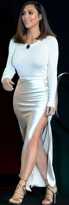 Who made Kourtney Kardashian's gold sandals and satin skirt?
