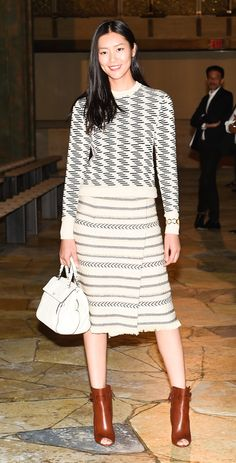 Lui Wen attending the #ToryBurchSS16 show wearing our Resort 16 collection with Fall 15 boots