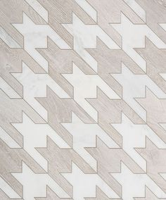 The Sterling Row Houndstooth pattern in Linen, features light beige porcelain tile contrasted with pure white Thasos Marble.