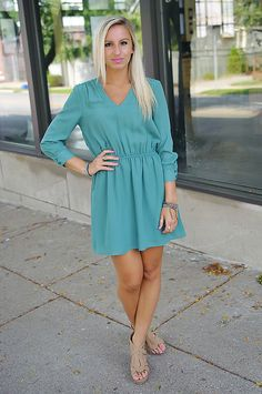 Piace Green 3/4 button sleeve dress with a v-neck and elastic band waist.  Lined.