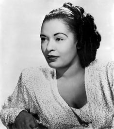 "Billie Holliday - ""Her glossy black hair was often studded with creamy gardenias – a look that became her signature – and she had a sensuous beauty that matched her distinctive, emotion-filled voice, which allowed her to instill such feeling into songs like Strange Fruit and Good Morning Heartache."""