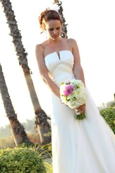 Love this picture great view of the dress with bouquet