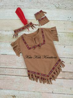 Girls Native American Indian Inspired Costume. This is a great outfit to wear for Halloween, Thanksgiving, plays, pageants, and just to have fun playing Indian. Dress is a tobacco brown soft faux suede cloth with hand cut fringe at the sleeves and hem. It is embellished with an eagle braid trim and beads on the hem fringe. The outfit includes adjustable headband and ankle bands. ♥THIS LISTING IS AVAILABLE IN SIZES 2/4, 6/8, and 10/12. THIS LISTING IS MADE TO ORDER WITH A TWO WEEK PLUS…