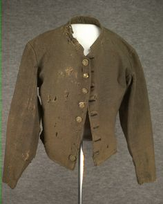 Confederate Enlisted Shell Jacket of J. P. Hichman, 7th Tennessee Cavalry Regiment.  Dark gray wool with eight button front. Tennessee State Museum Collection.