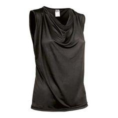 Camiseta de mujer sin mangas Referencia  PIN-UP Marca:  Valento  Camiseta de mujer sin mangas con diseño desenfadado y elegante. Escote drapeado, haciendo ondas. Doble pespunte en bajo. Confeccionada en tejido punto liso elástico, brillante y suave, muy agradable al tacto.