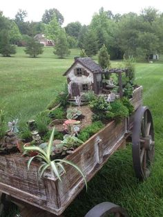Adorable miniature house and yard in a cart.