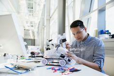 Stock Photo : Focused engineer assembling robotic car