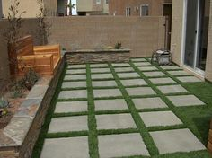 Mixing materials is a favorite of ours. It adds a modern feel to the space. Here we added artificial turf inbetween concrete stepping stones. On the left side you can see a great wooden bench that we built for the client as well. They were over the moon happy with the way thier yard turned out.