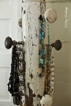 a jewelry tree using an old porch post, a reclaimed finial, some old doorknobs, and a few pieces of reclaimed wood: