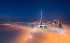 Photographer Daniel Cheong spent the past six months photographing the record-breaking skyline of Dubai, UAE, at just the right moments. Burj Khalifa, the worlds tallest building at feet, is seen here from the floor of the Index Tower. Dubai City, Dubai Skyscraper, Dubai Uae, Dubai Skyline, Camera World, To Go, Creative Photos, United Arab Emirates, Burj Khalifa