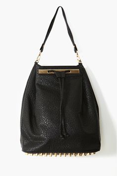 Studded Backpack....everybody's bag rolled into one but pretty cute at a price.