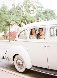 Vintage White Getaway Car | photography by http://www.krystleakin.com | floral design by http://liliumflorals.com/