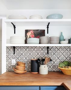 Lovely tiles, wooden countertop, blue kitchen cabinet and open shelves on top. Love it!