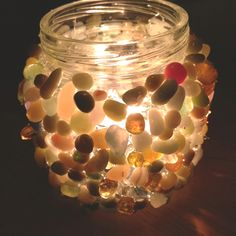 Baby food jars, craft stones, and hot glue :)  I would try shells!