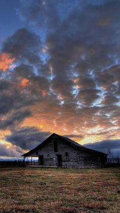 Cloudy Sunset Over Old Barn -beautiful old barns such as these inspire the design of our unique reclaimed barn wood furniture - www.braunfarmtables.com