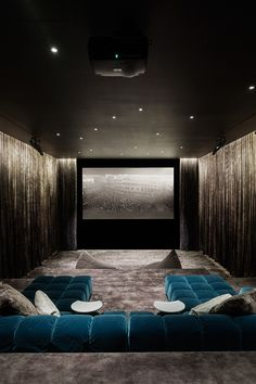Gorgeous silver and teal/blue #hometheater. www.homecontrols.com