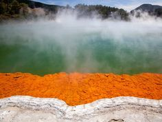 """Soak your feet in the hot springs of Rotorua, a New Zealand city known for its geysers, thermal springs, and bubbling mud pools. It's nicknamed the """"Sulphur City,"""" and visitors can also partake in water sports in the region's 17 lakes."""