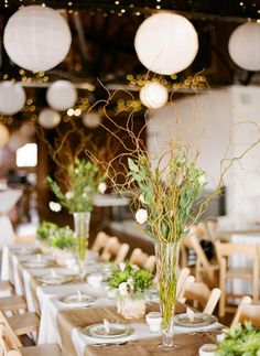 Wedding Party Table with unusal floral displays and paper lanterns