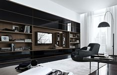 This is great inspiration for the wall unit at family room. Must design it 'warmer'…. concept is exactly what I had in mind. Poliform - Wall System More
