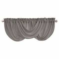 """Rod pocket swag valance in gray with handcrafted draping.  Product: ValanceConstruction Material: PolyesterColor: GrayDimensions: 18"""" H x 42"""" WCleaning and Care: Machine wash"""