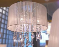 If not a chandelier, try one of these opaque drop-diamond light fixtures. Beautiful.