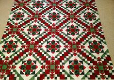 Bonnie Hunter's Easy Street pattern in Christmas colors.