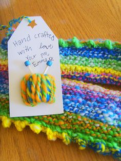 Cute gift tag idea: Take a bit of card stock and wrap your yarn around it. Secure it with glue. Make tiny knitting needles out of tooth picks; add beads on the ends.