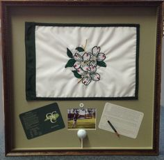 """Custom """"Hole in One"""" shadowbox. This frame includes the flag, scorecard, photo, ball and golf course details."""
