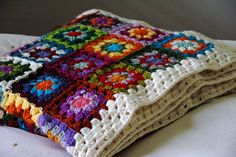 Vivid granny squares bordered by white.