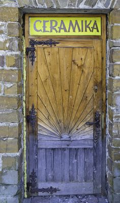 Door, Dom Ludowy, Bukowina Tatrzańska, Poland -- love the craftsmanship, not so much the colors, love the iron
